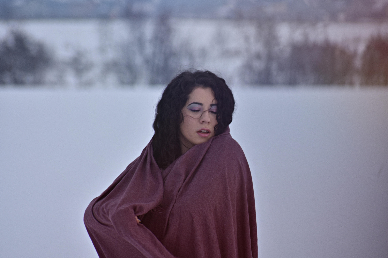 0e9dfb33a4 adult close up cold facial expression female portrait pretty snow wear  weather winter woman