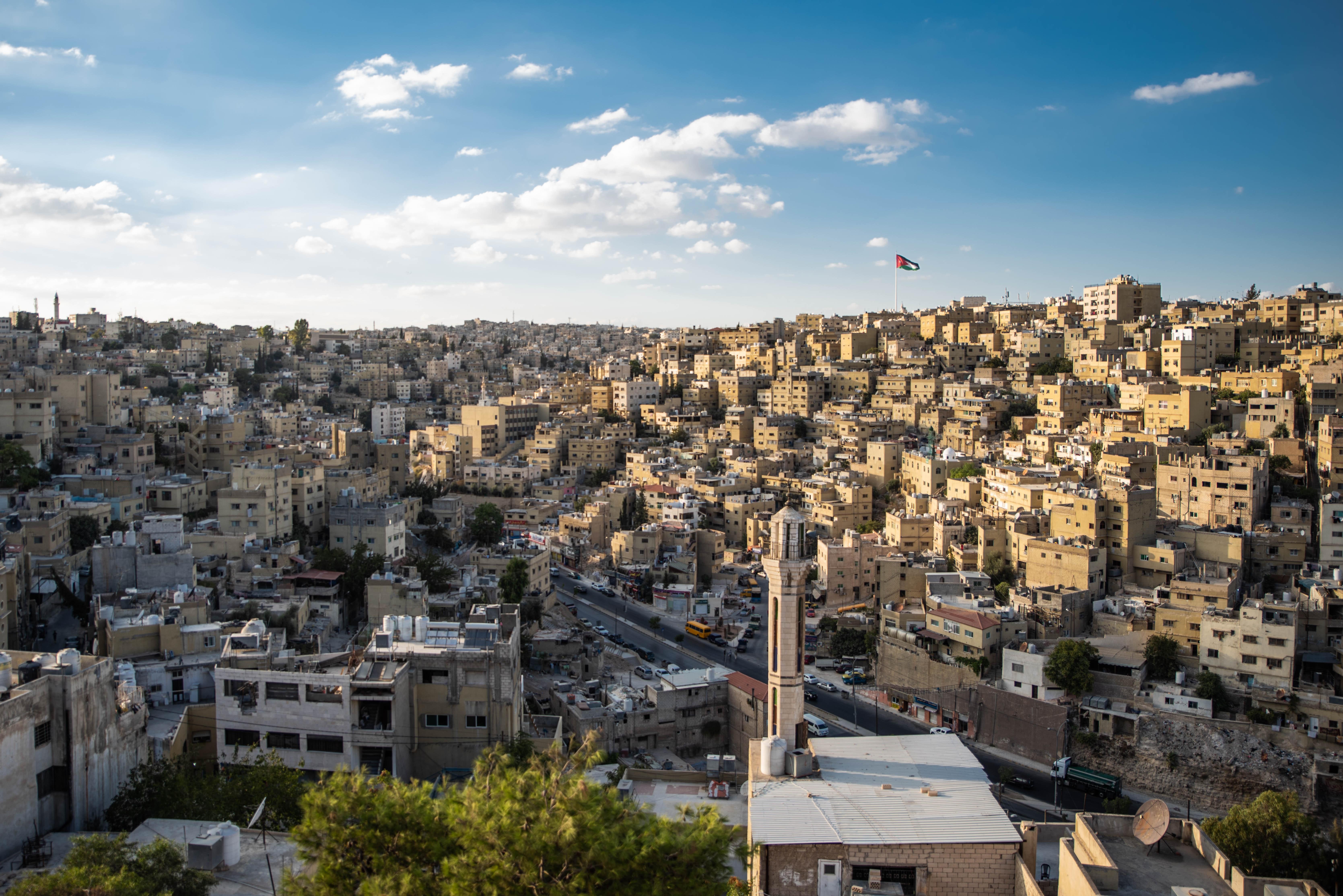 d819fcbb47a1 aerial shot amman buildings city cityscape flag jordan skyline town urban