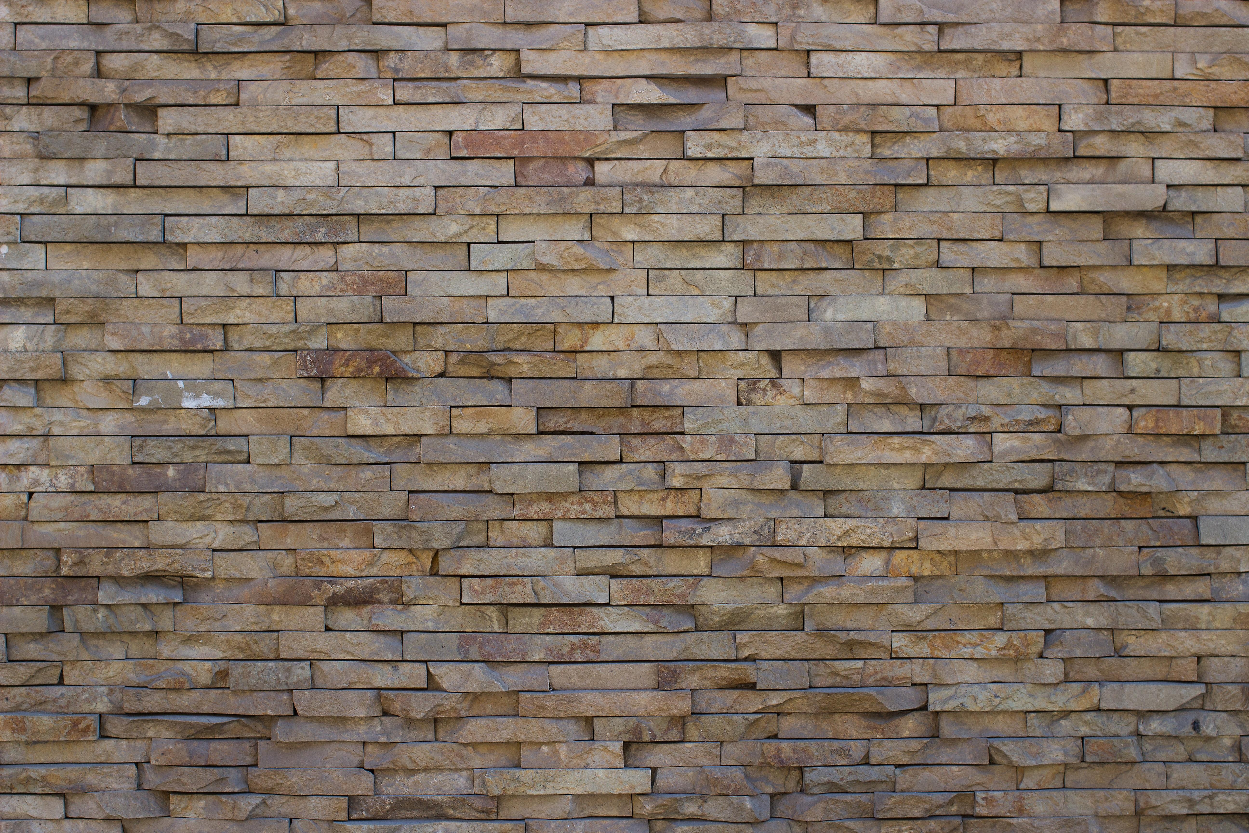 Primo piano texture di piastrelle di pietra manifesti da muro