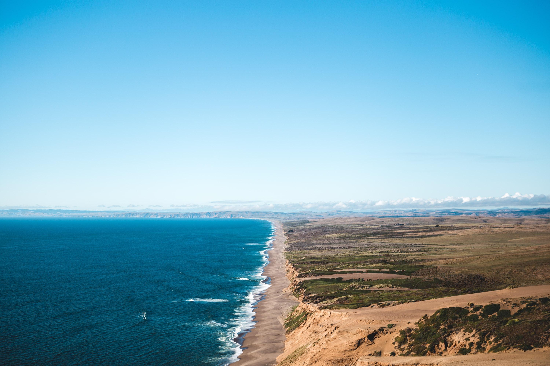 Images gratuites plage paysage mer c te le sable for Agence horizon paysage