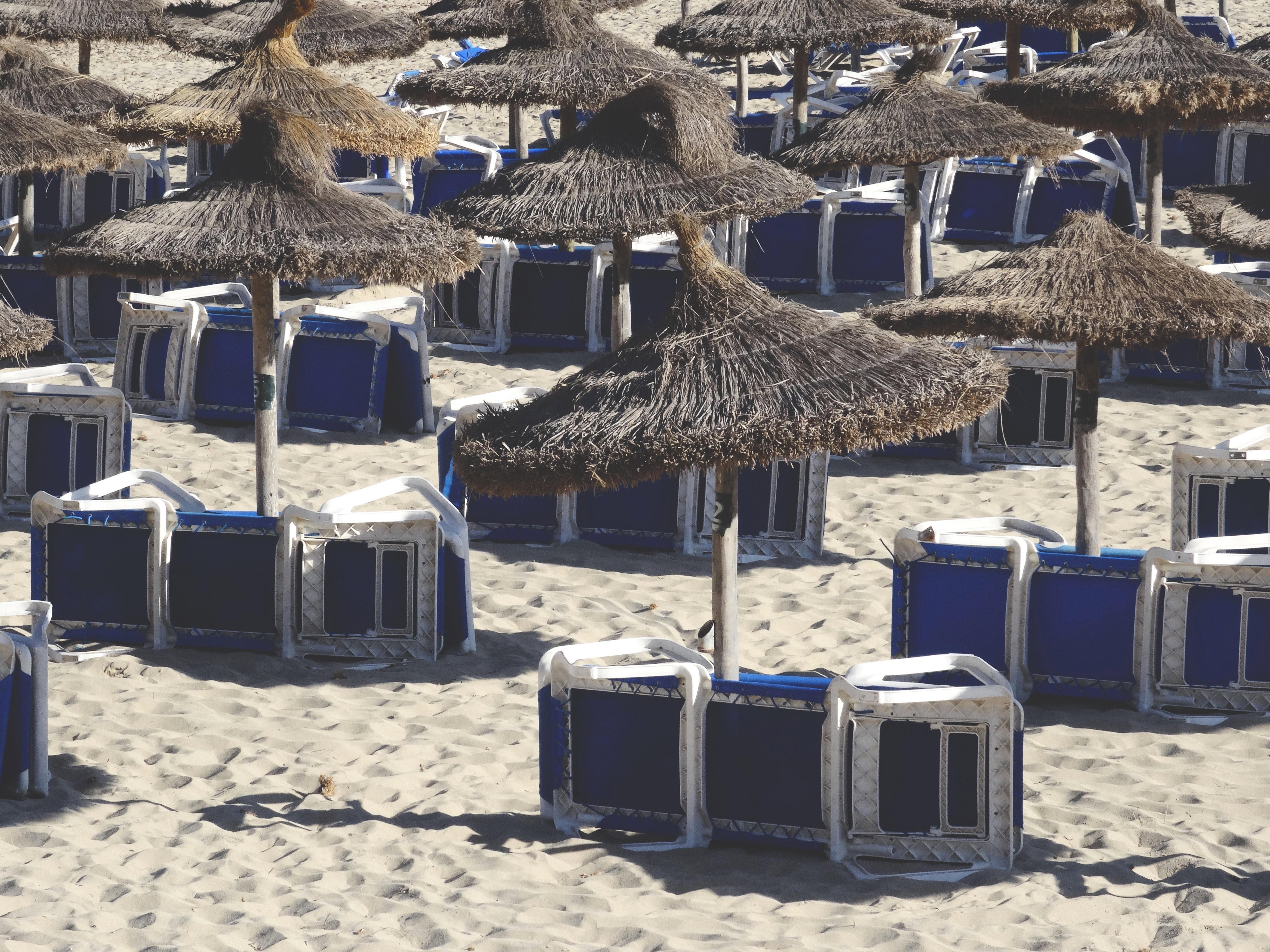 beach sand snow winter summer hut village christmas decoration umbrellas lounge chairs