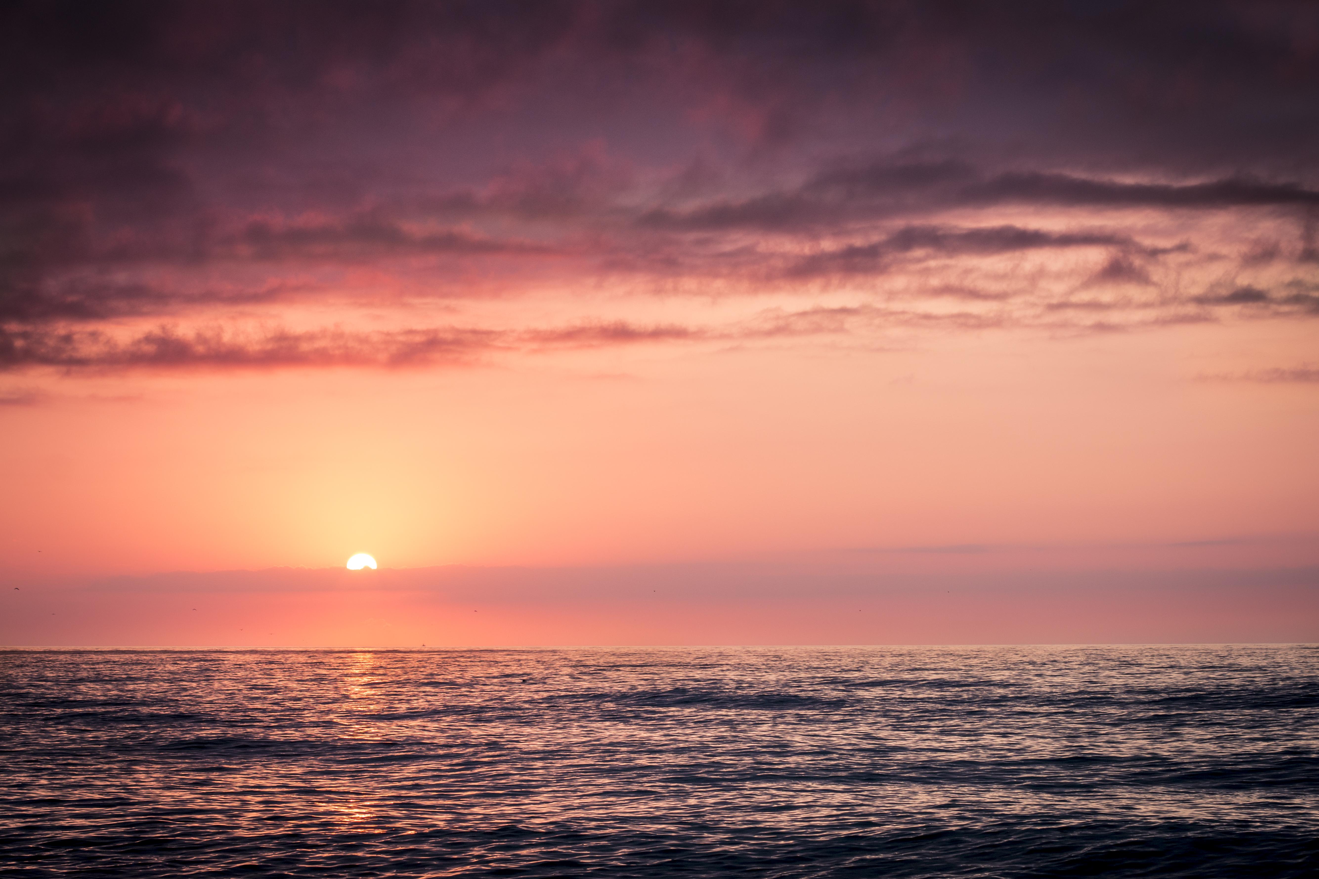 sunset ocean nature water sun horizon sunrise sea beach sky sunlight dusk morning evening dawn seawater domain cloud wave afterglow