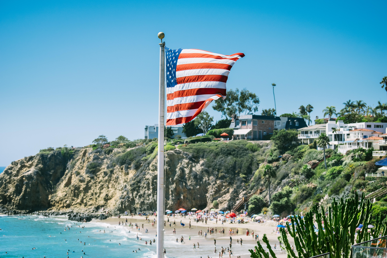Beach Sea Coast Water Ocean People Sky Walkway Vacation Amut Park Tower Flag American United
