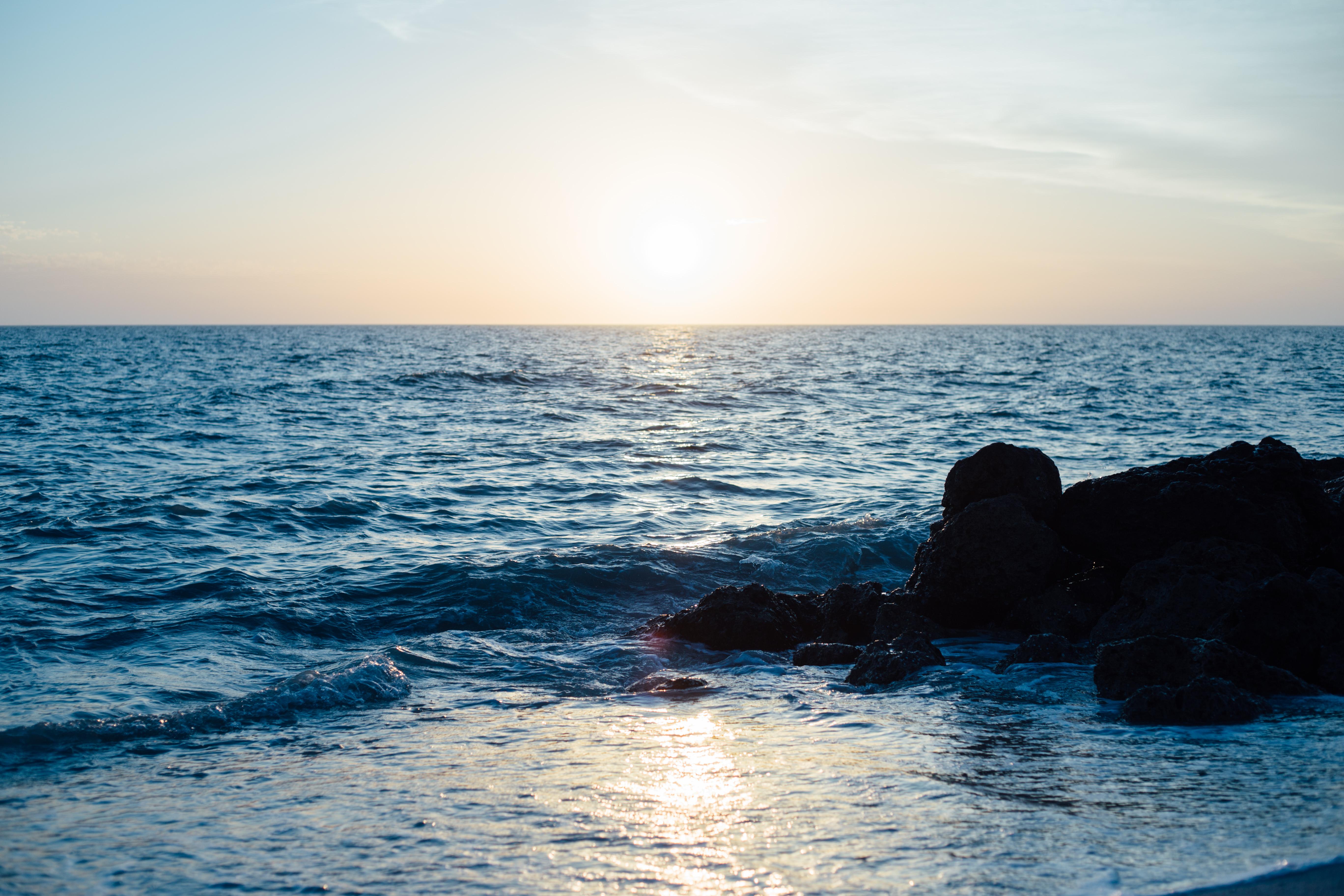beach sea coast water rock ocean horizon sunrise sunset sunlight shore wave dawn coastline dusk seascape