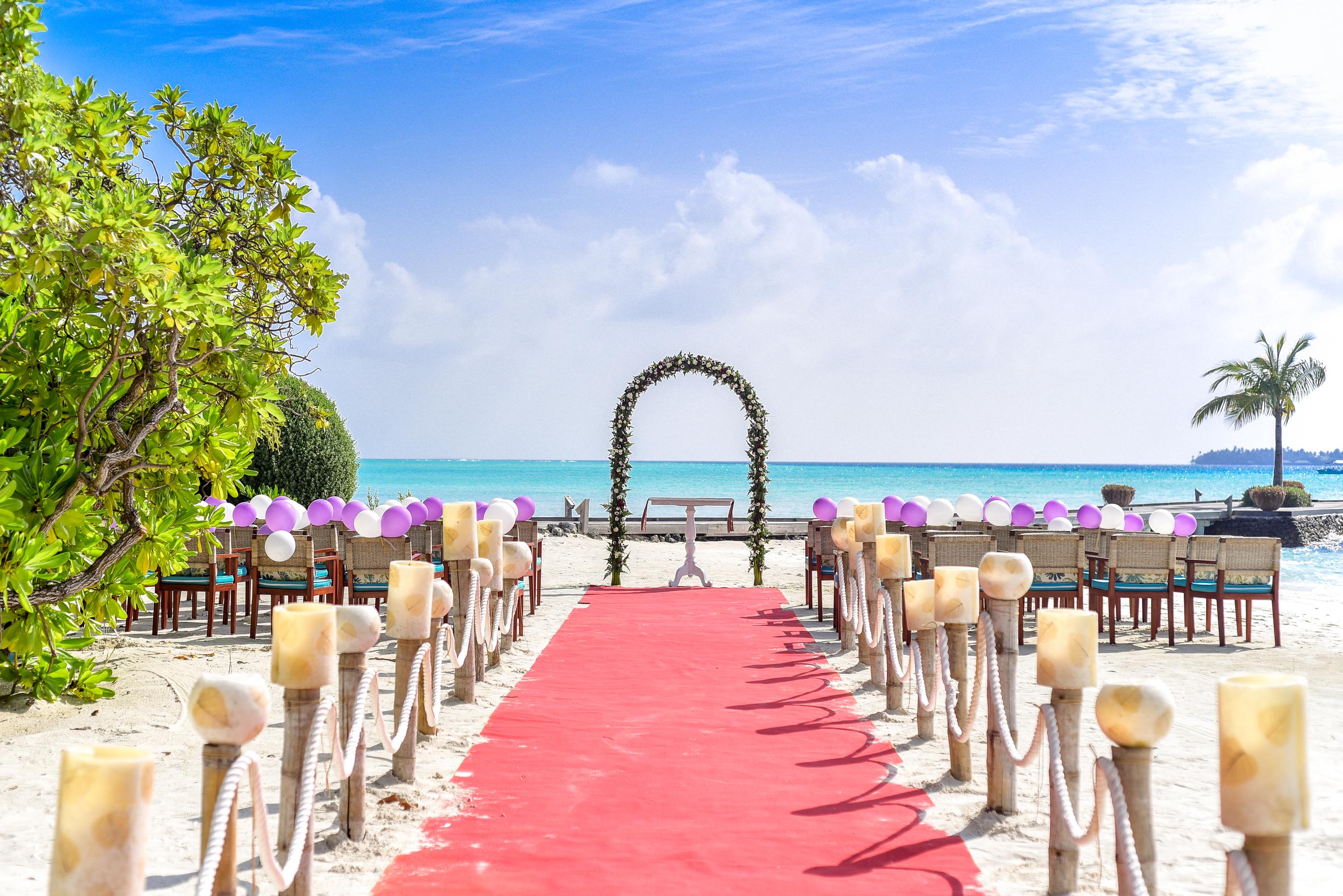 Seas Trees Chairs Luxury Resort Balloons Lanterns Estate Decorations Destination Beach Wedding Red Carpet Setup Arch