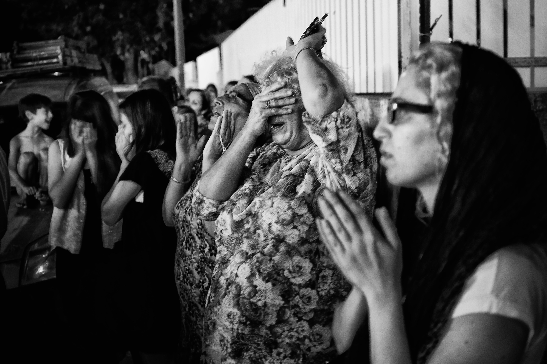 Black and white street photography fujifilm fashion black monochrome praying candid hands faith photograph x100s 16