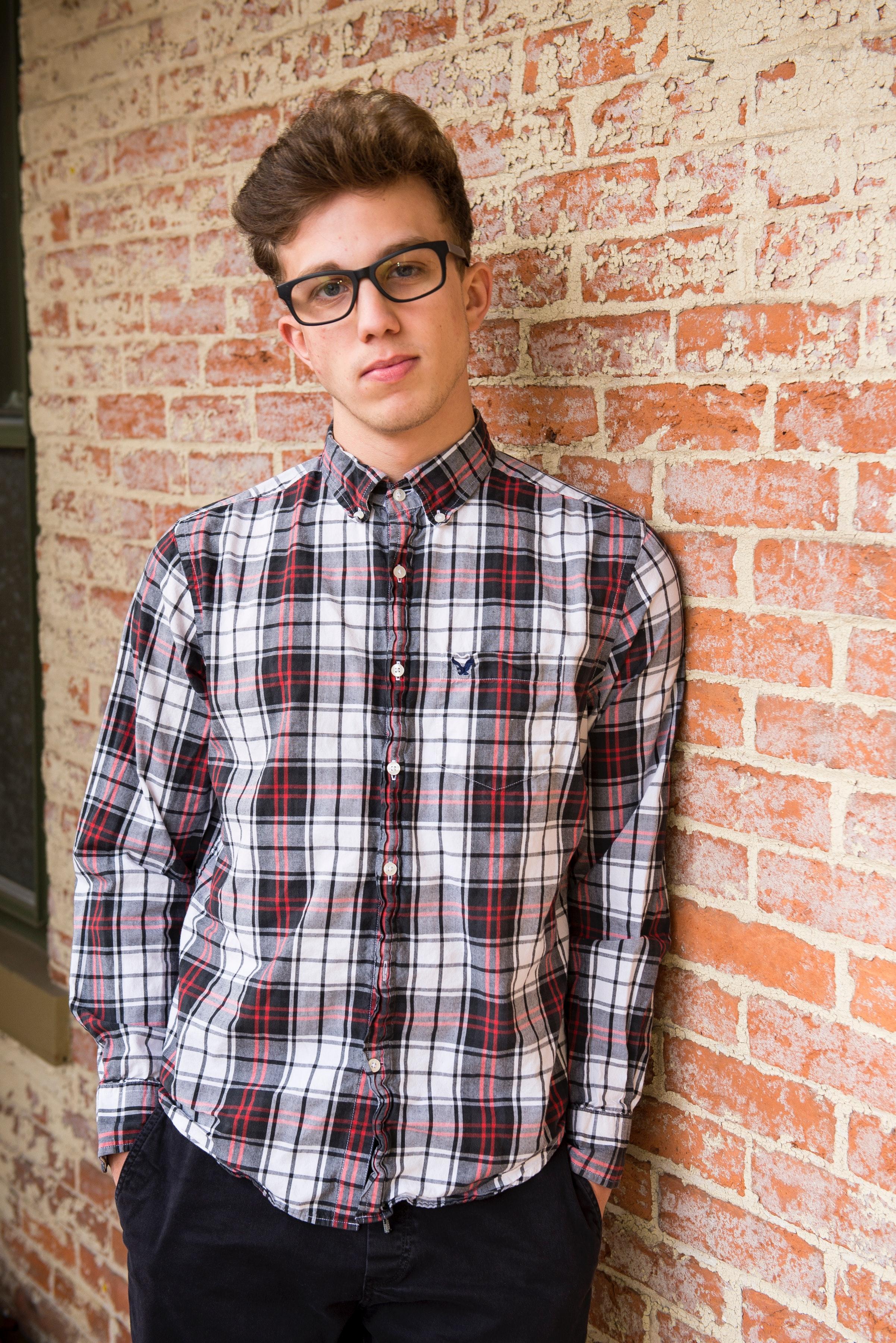 brick wall casual eyeglasses eyewear fashion fashionable fine looking good  looking man person shirt style trendy 4c11b610a948