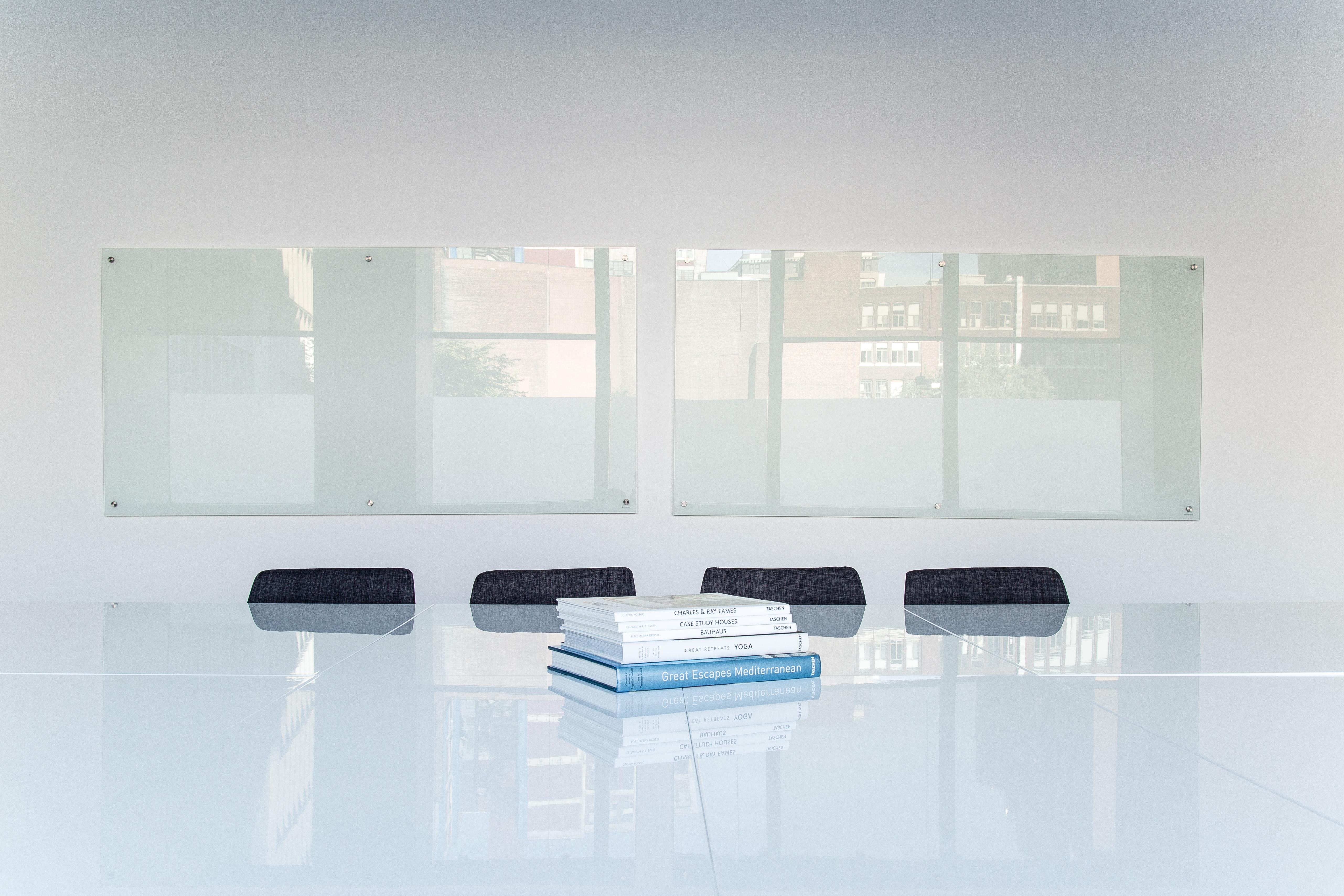 Free images desk table white glass wall pile shelf for Lighting for interior design book