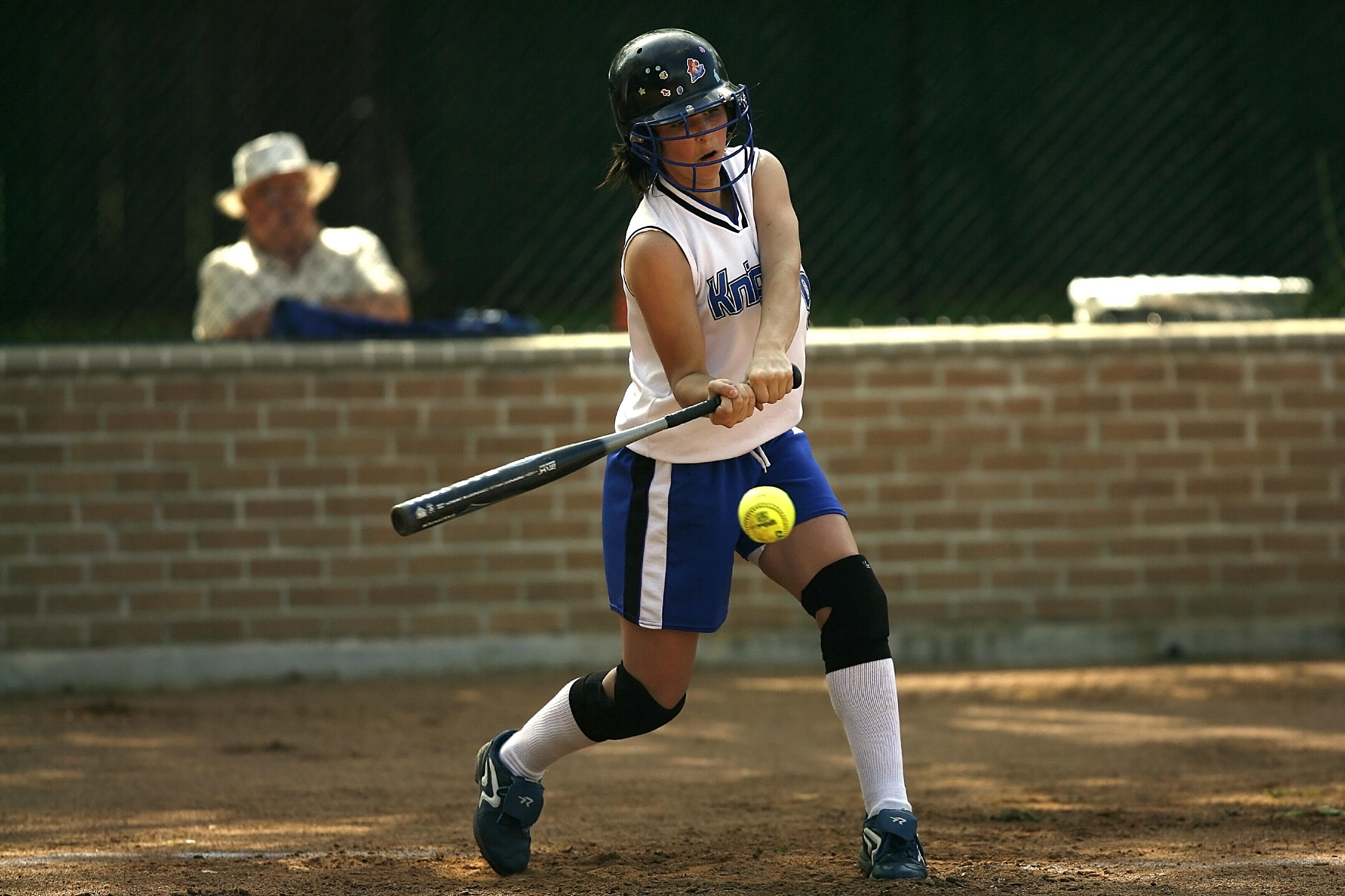 Woman swinging a softball bat