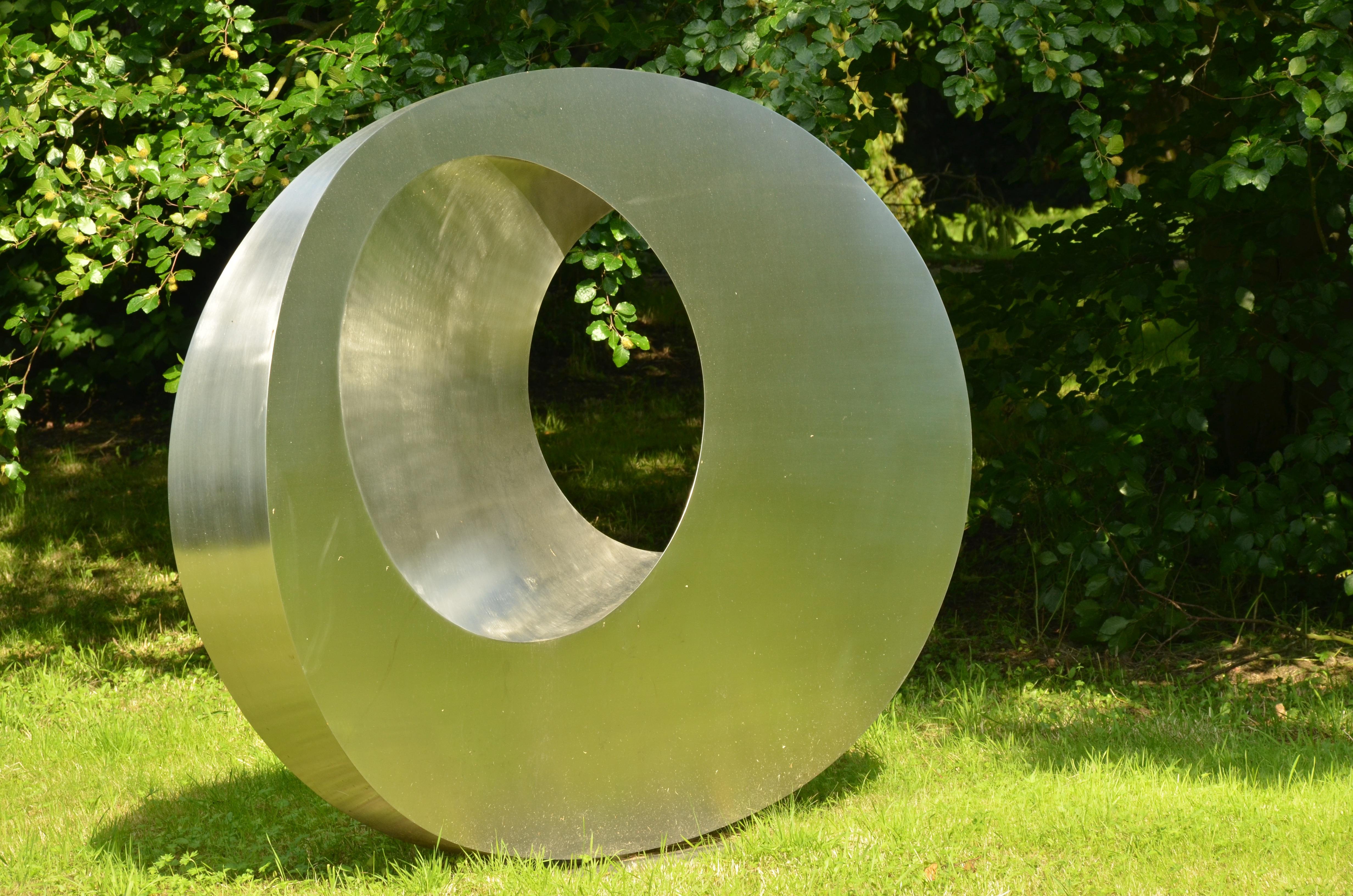 Free Images : grass, lawn, wheel, green, metal, circle, sculpture ...