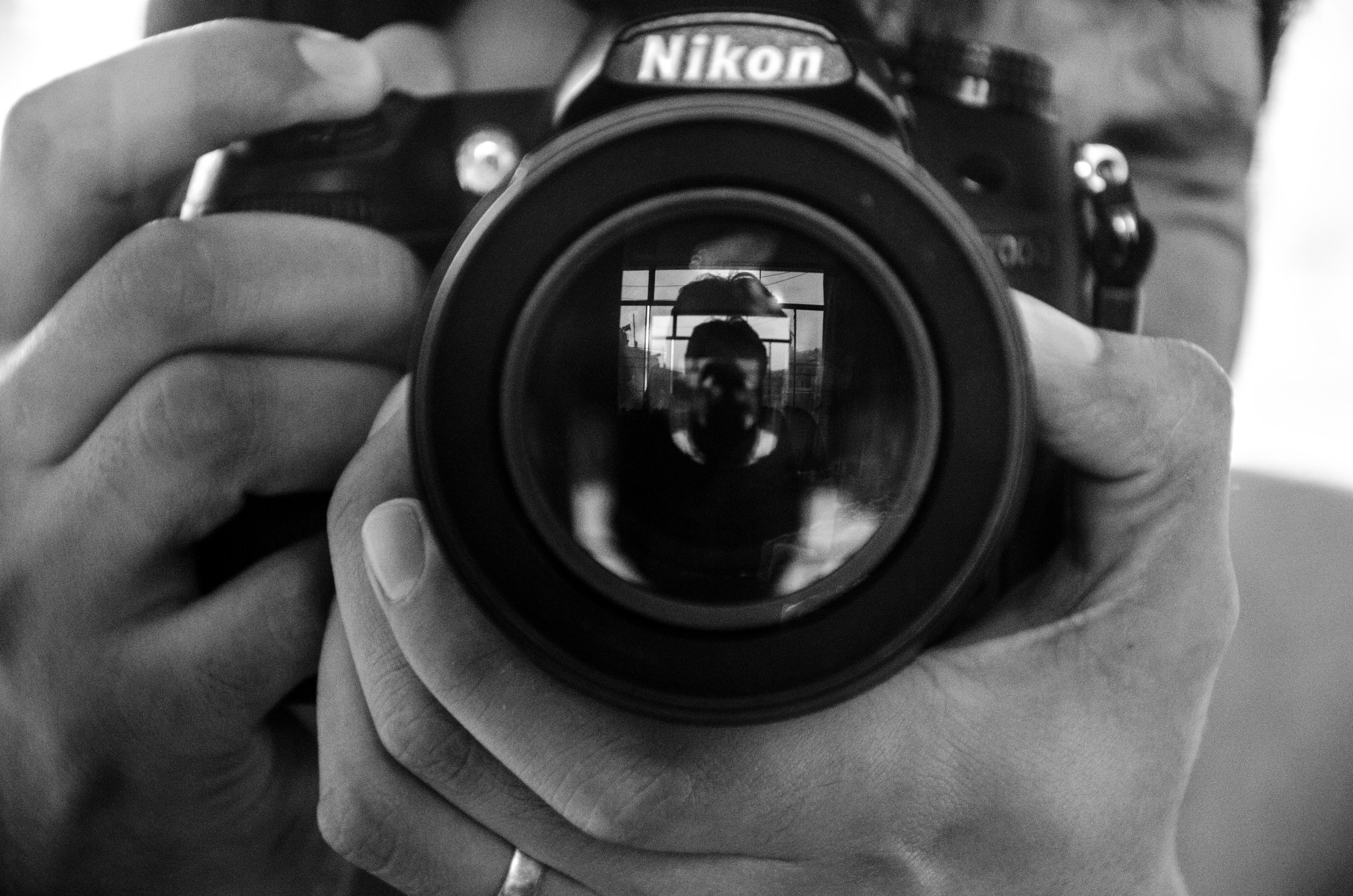 hand-black-and-white-camera-photography-photographer-wheel-nikon-black-monochrome-close-up-reflex-camera-digital-camera-photograph-camera-lens-monochrome-photography-digital-slr-single-lens-reflex-camera-cameras-optics-mirrorless-interchangeable-lens-camera-661739.jpg