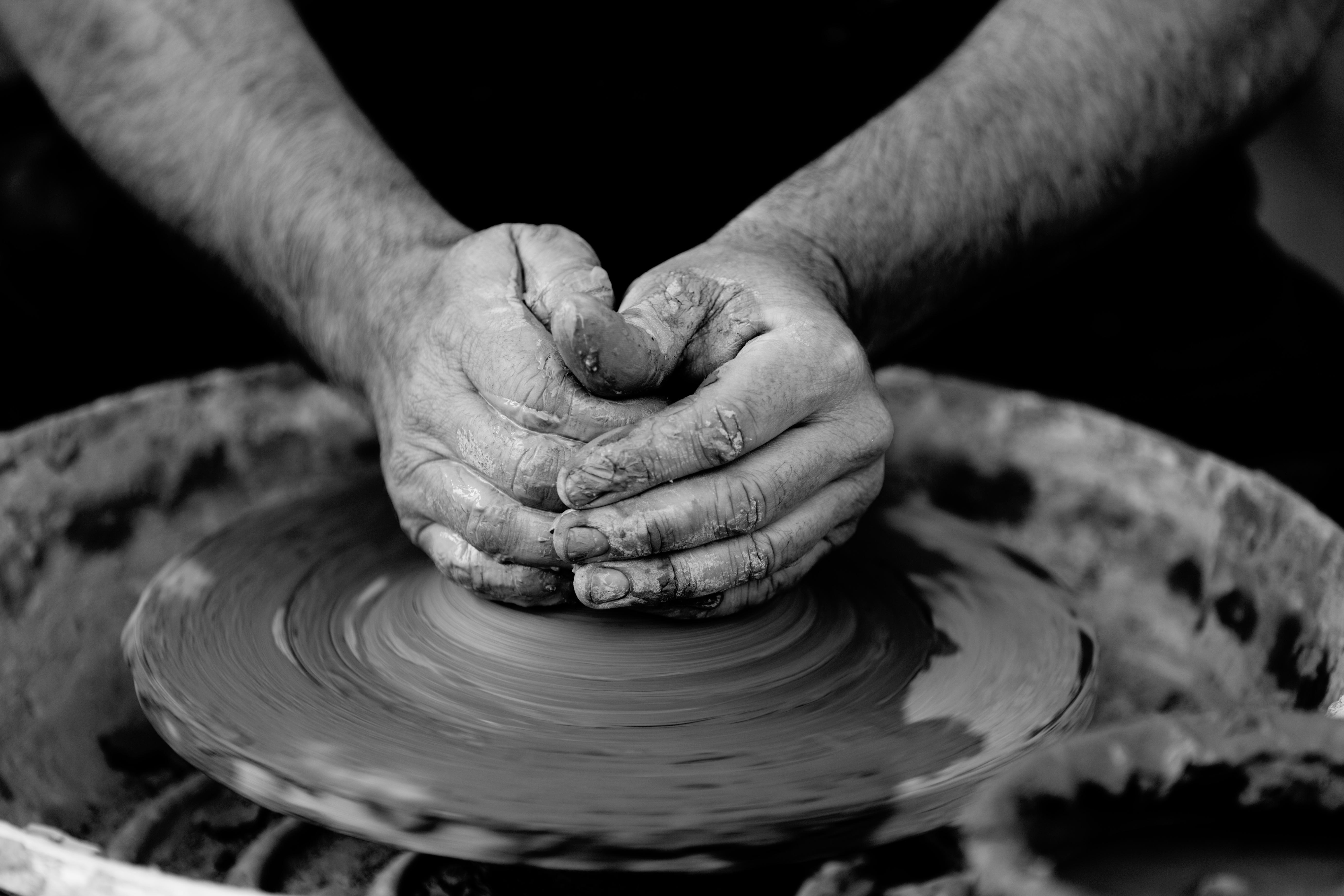 Hand black and white photography wheel ceramic machine black monochrome pottery circle close up art macro