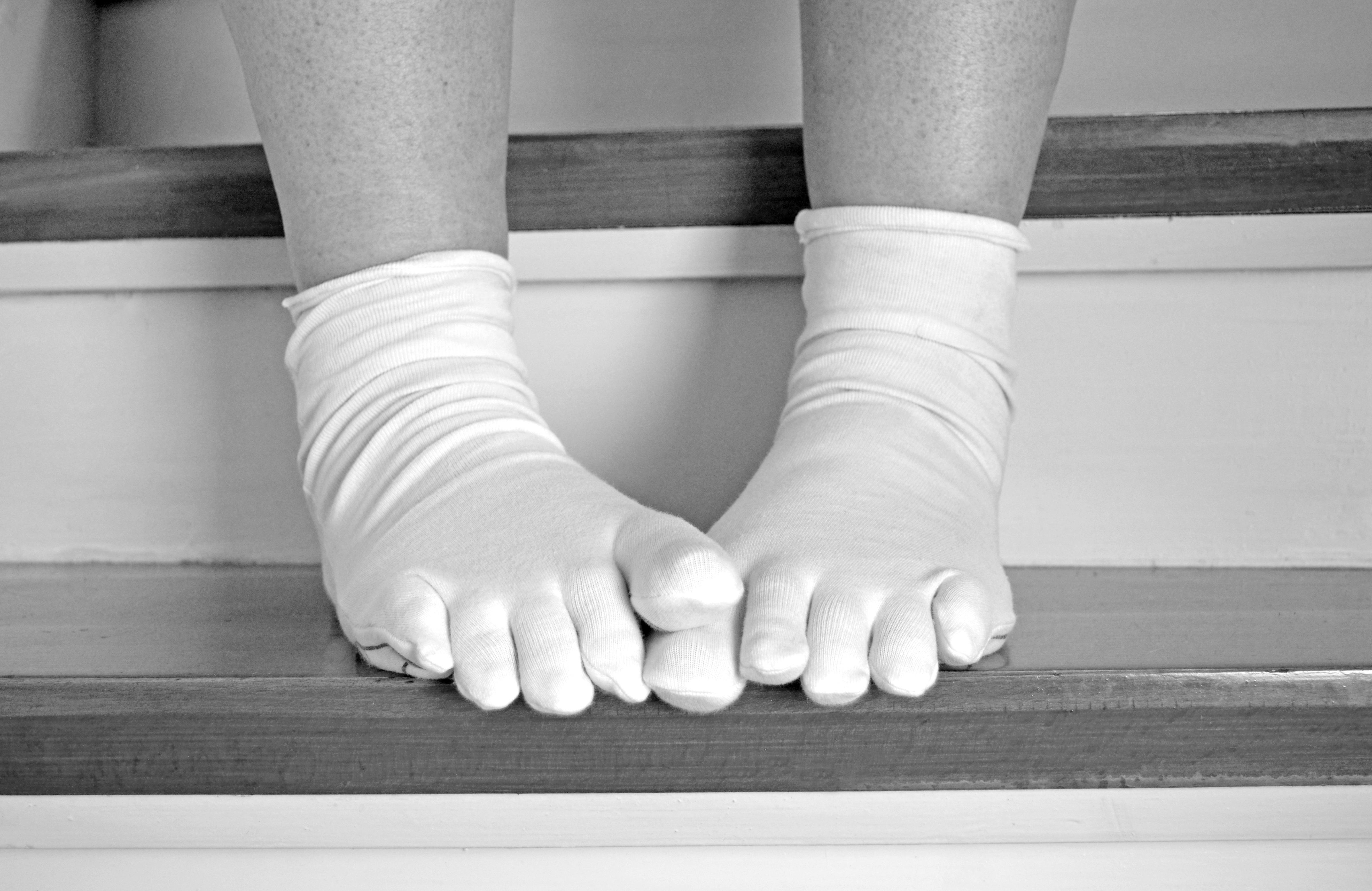 Calcetines y consoladores para los pies