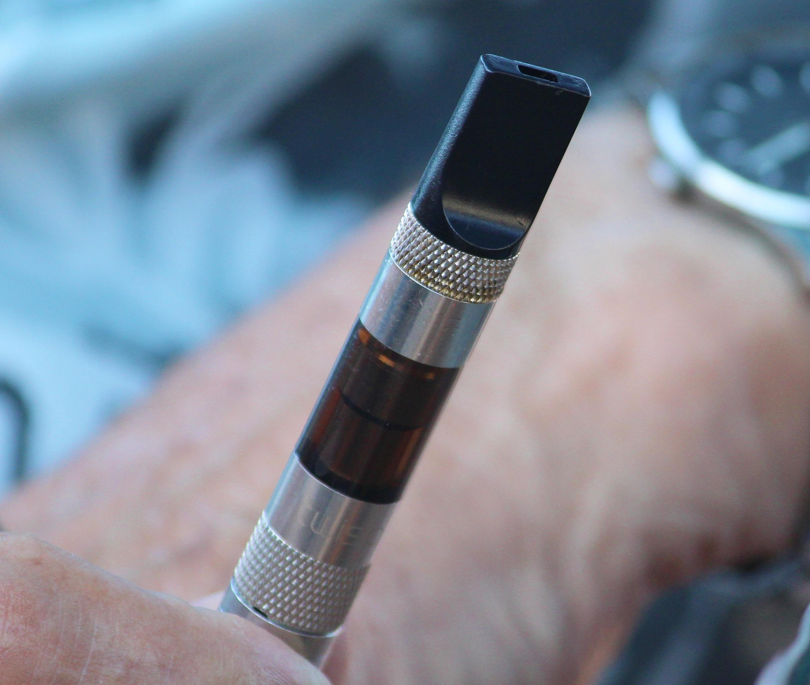 hand man smoke smoking product electric cigarette