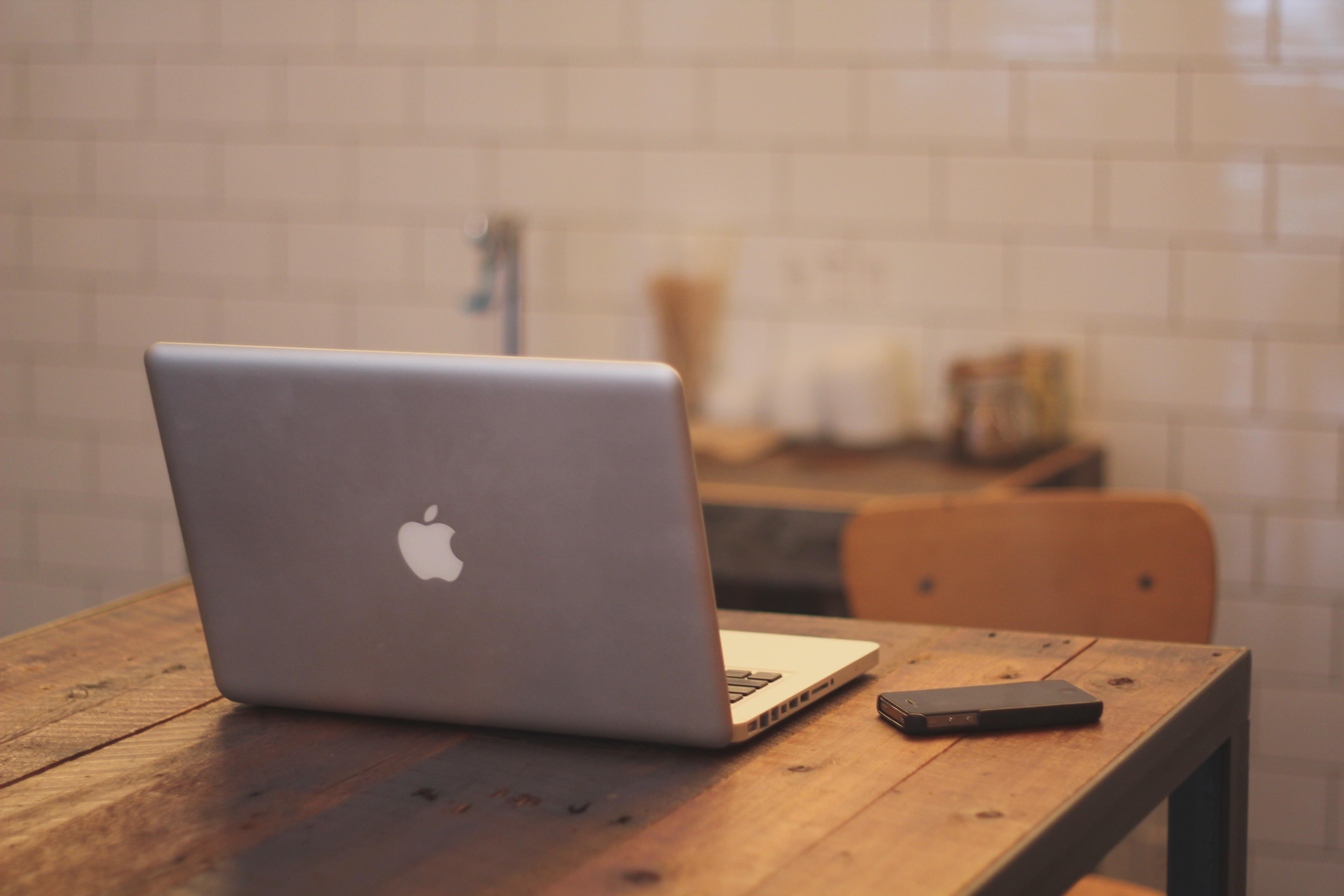 workstation lighting. Laptop Iphone Desk Notebook Macbook Writing Apple Table Wood Technology Chair Office Shelf Business Furniture Room Workstation Lighting