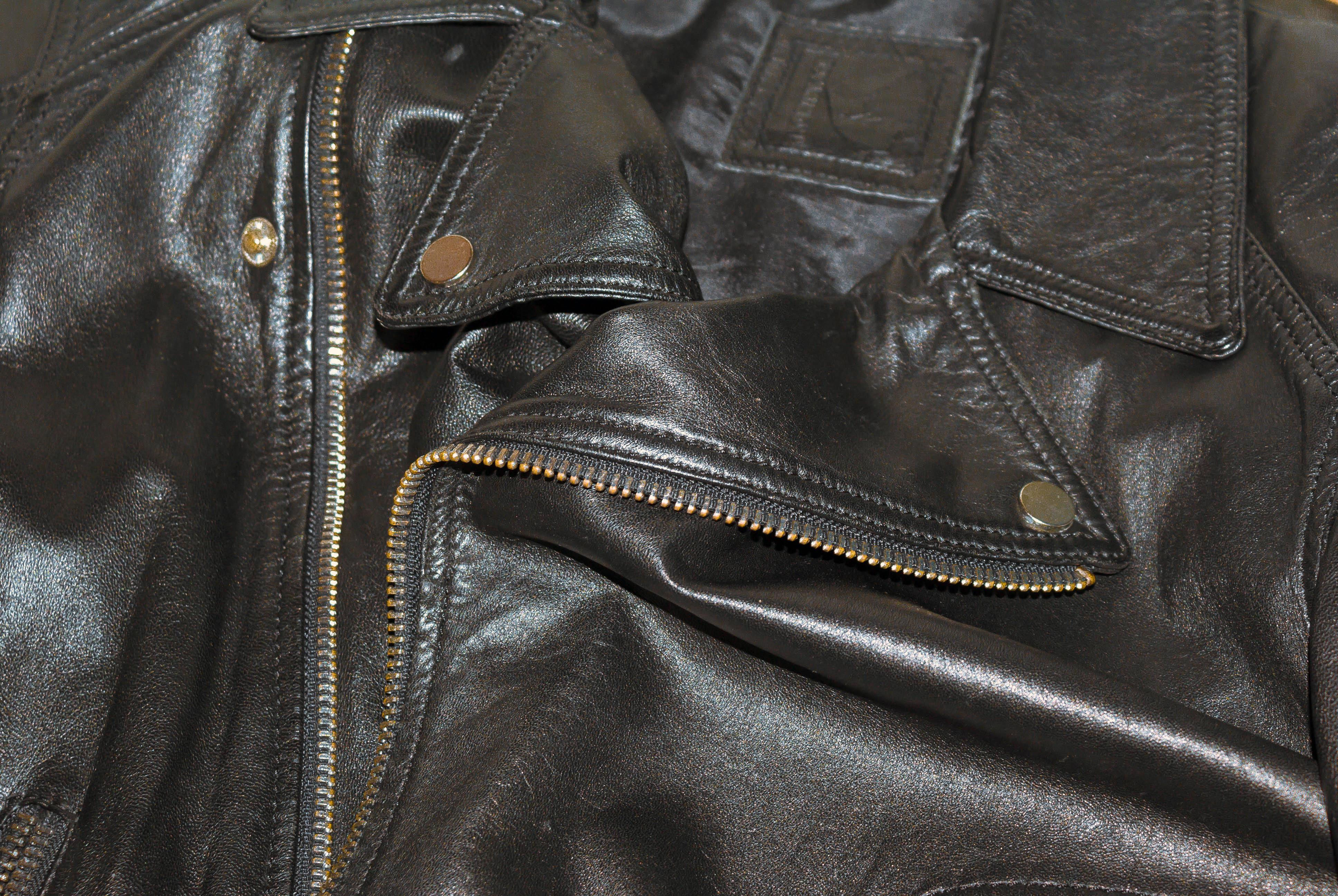 d7c462ba lær jakke tekstur svart skinnjakke brun tekstil glidelås materiale lomme  metall produkt