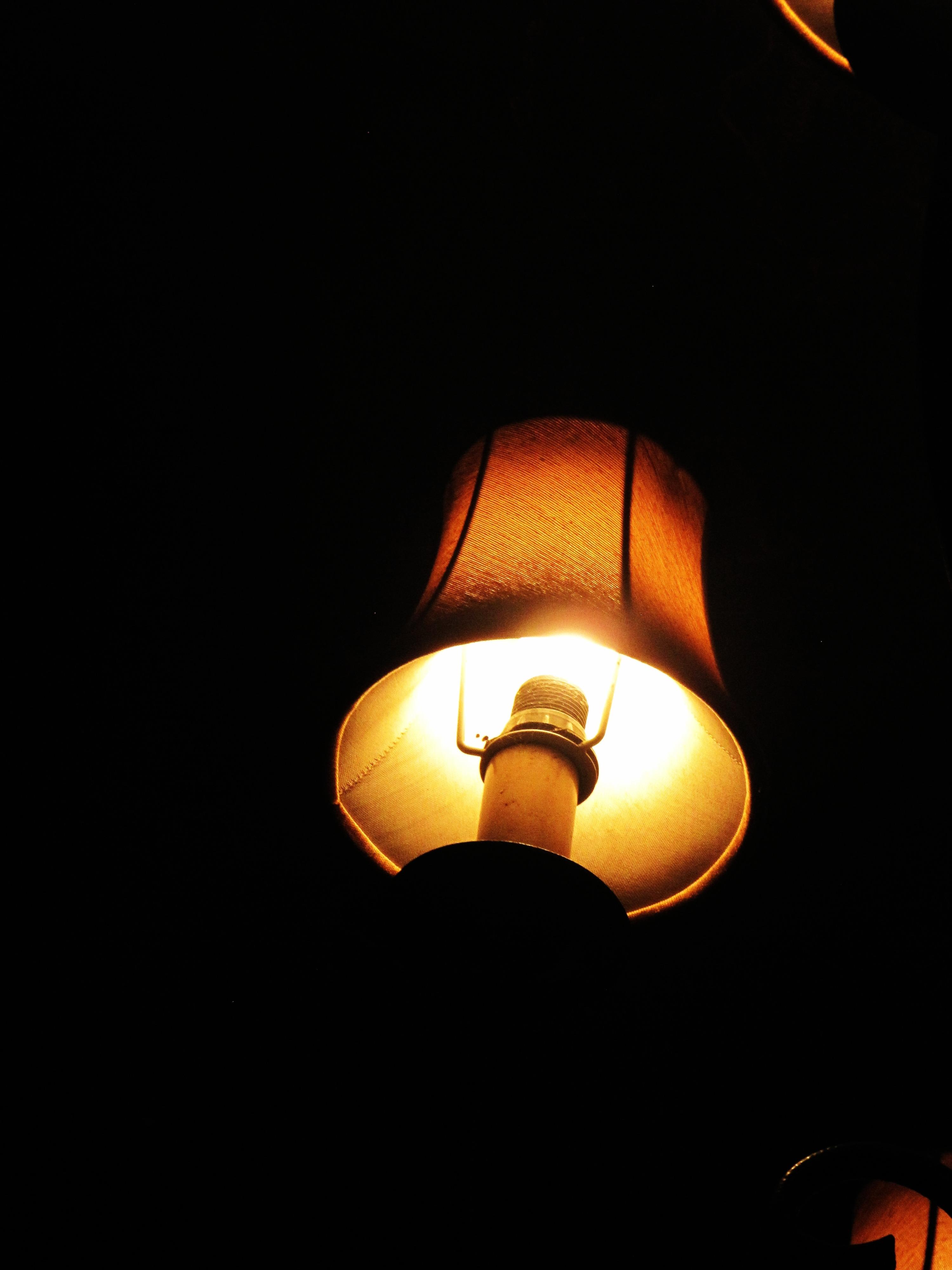 light shining dark darkness bulb lamp yellow bright glowing circle glow night lighting energy fixture flame illumination shine incandescent illuminated