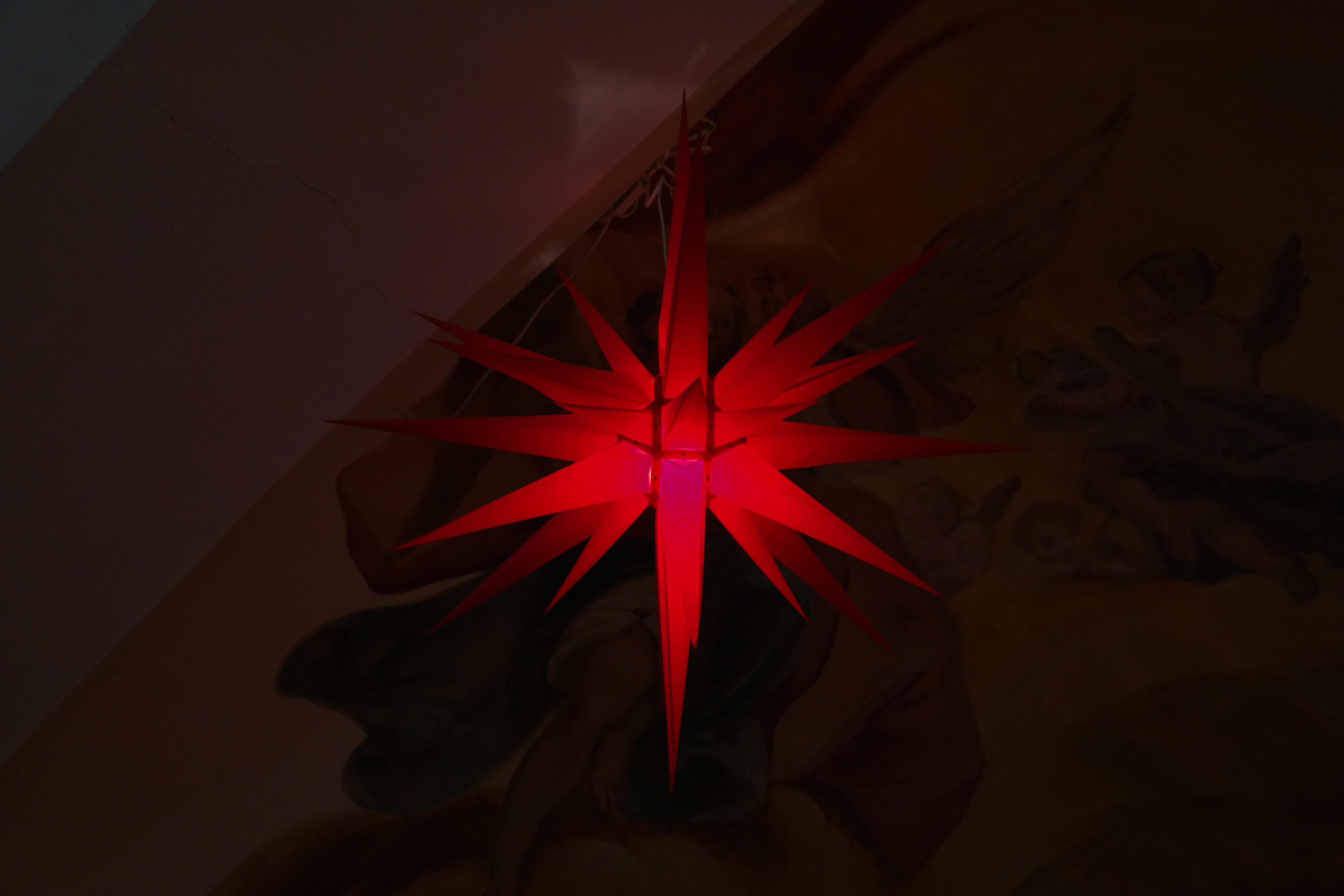 light star flower geometric red symbol color darkness christmas lighting circle art symmetry poinsettia shape screenshot