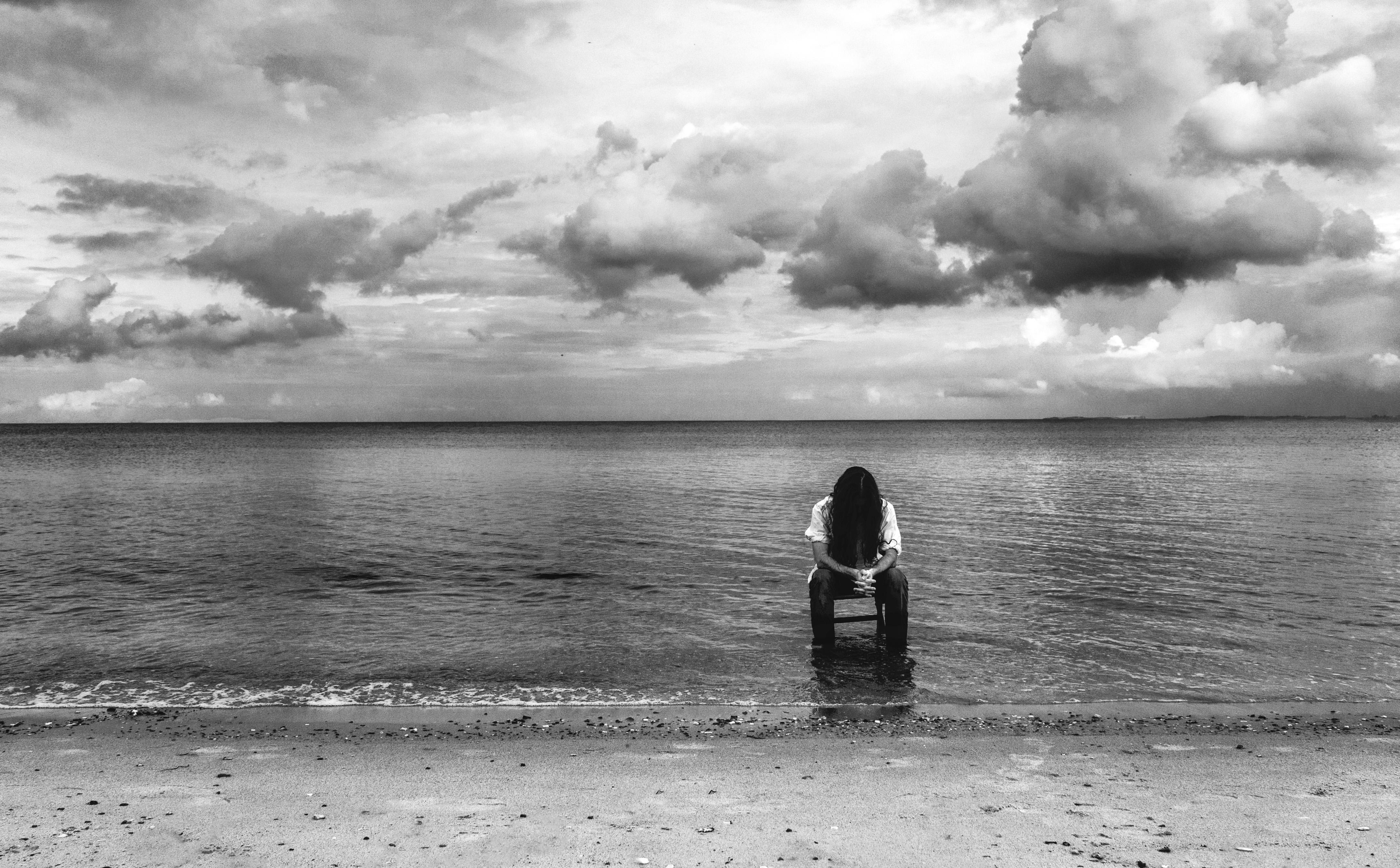 Man beach sea coast water sand ocean horizon cloud black and white sky white photography shore