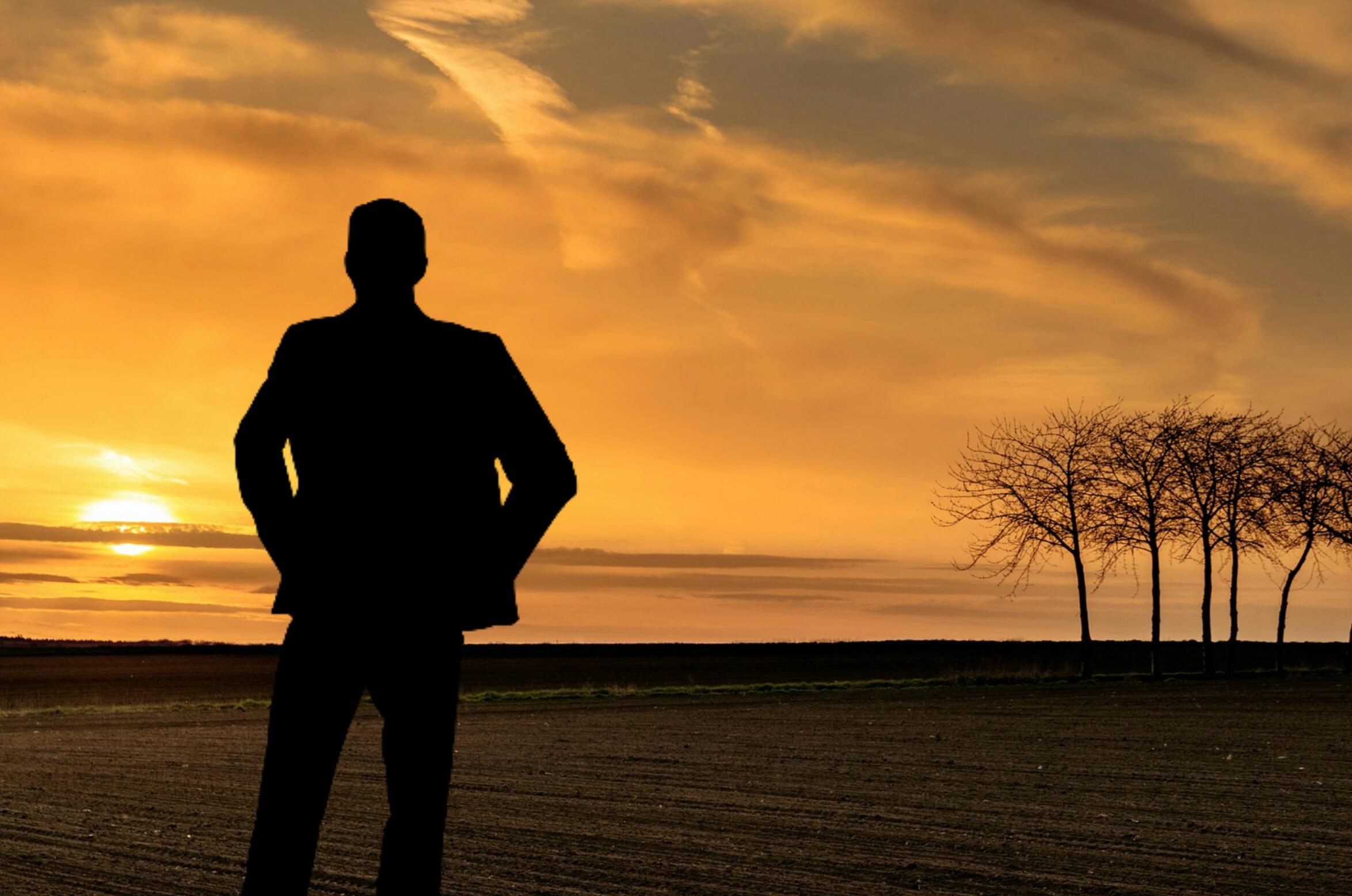 silhouette silhouette of man wearing hoodie looking down