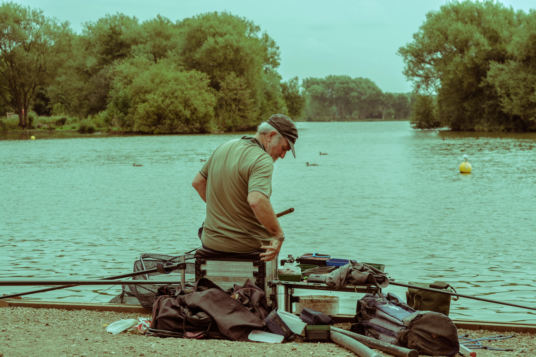 Free images man water lake fisherman leisure trees for Free fishing stuff