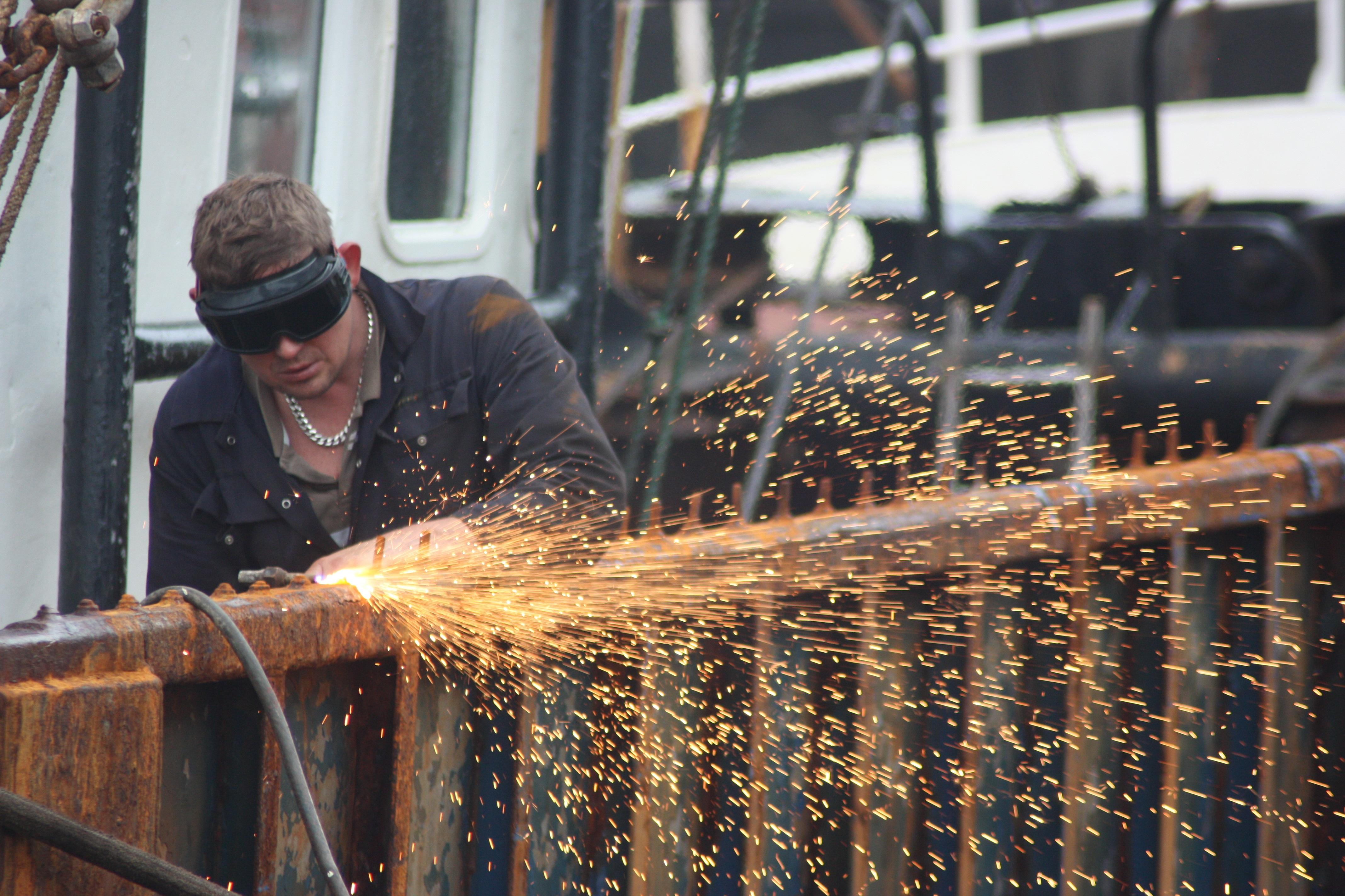 Free Images Man Water Wood Ship Metal Welding