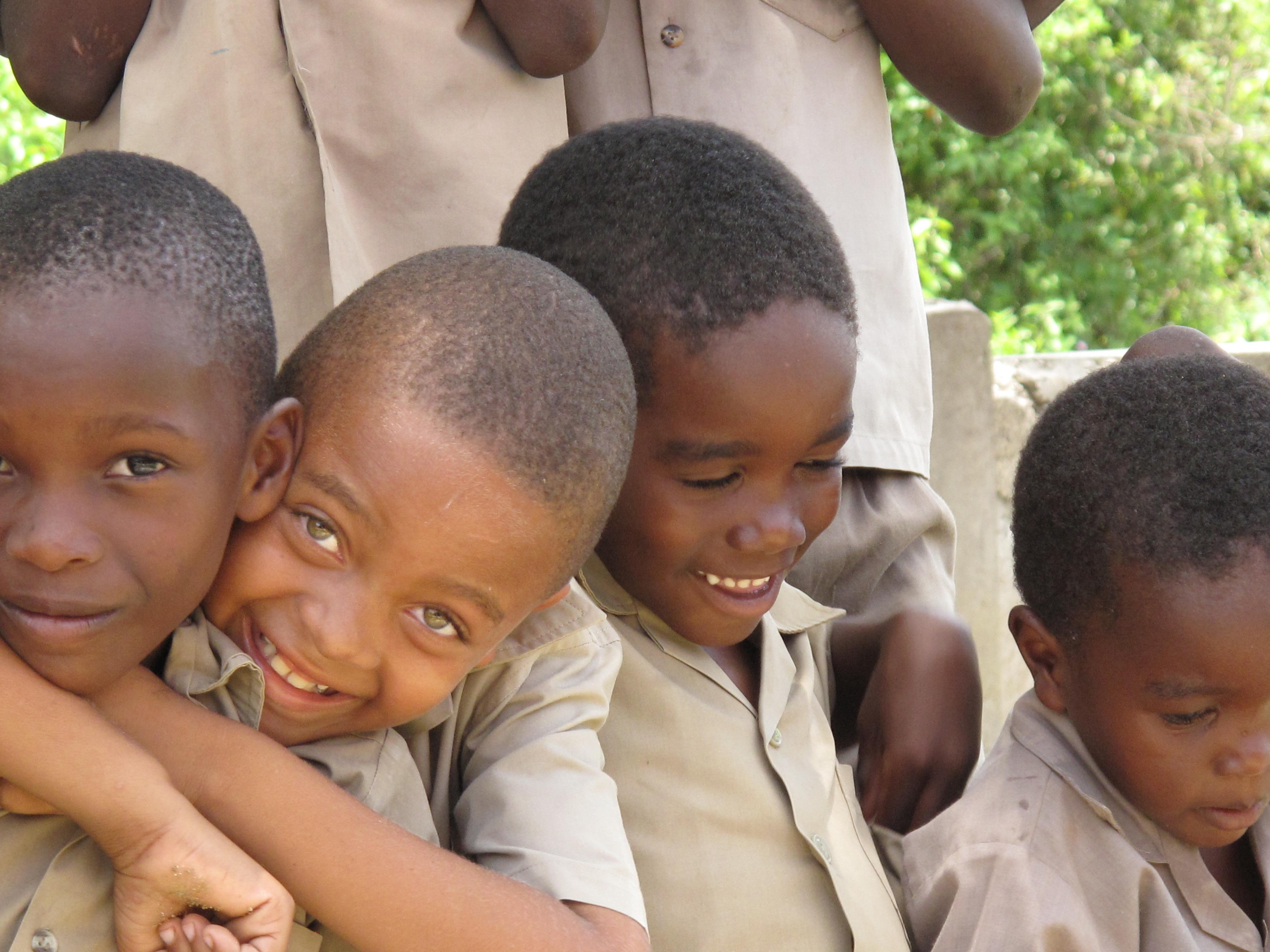jamaica boys smiling children child hugging education cute happy person outside portrait infant domain