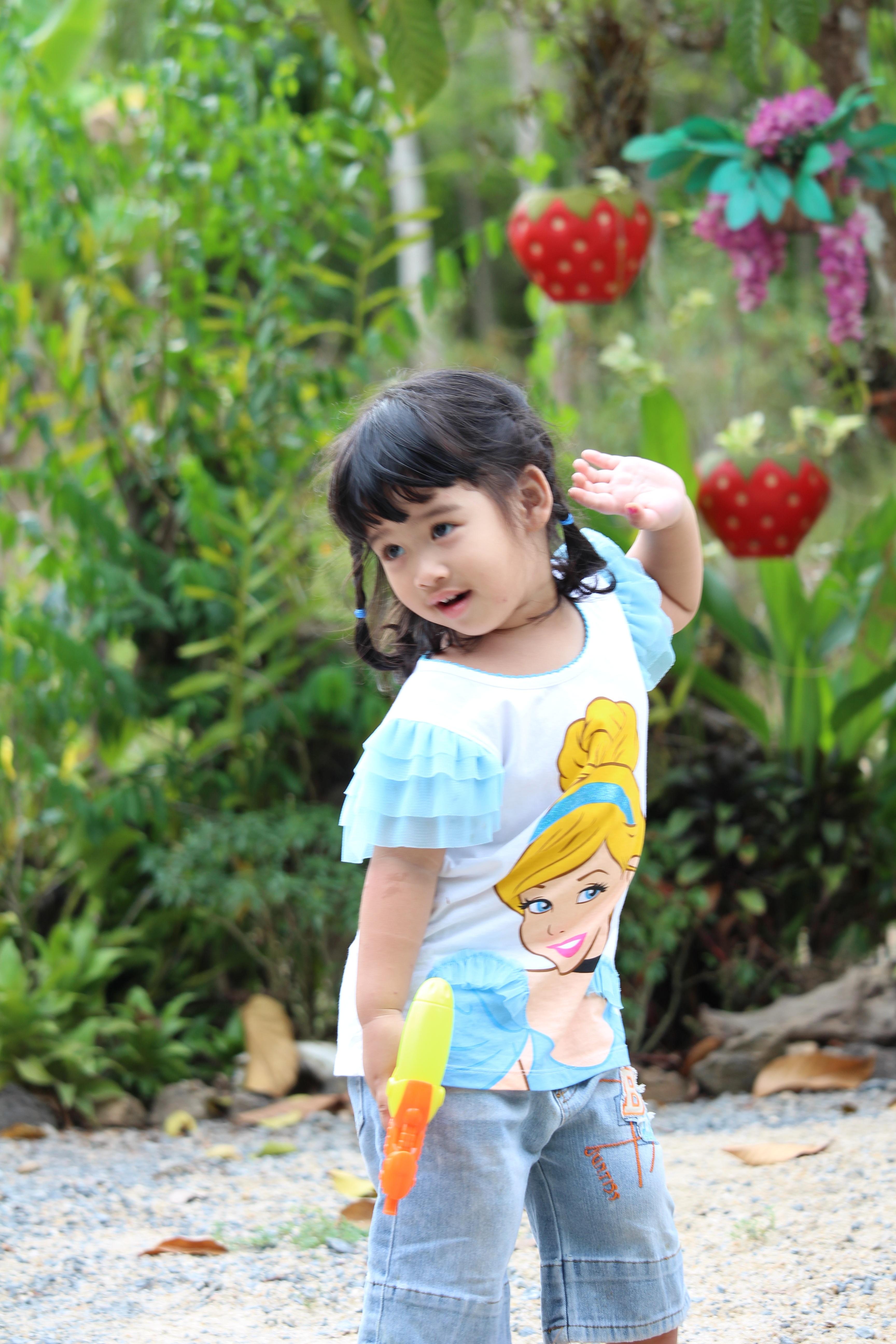 thai child person people girl game play flower spring autumn child season infant  toddler watergun pretty girl portrait