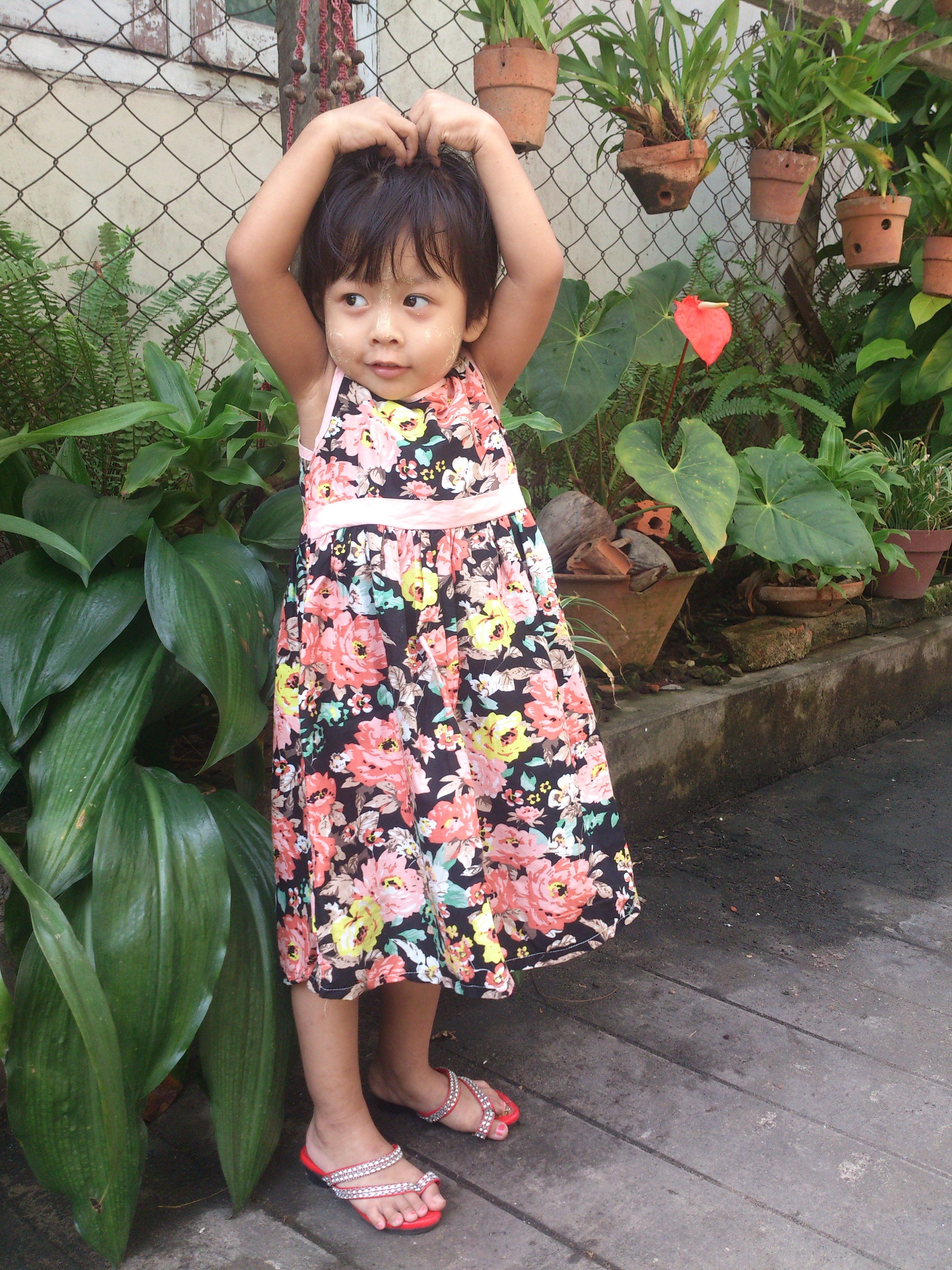 Good young little girl flower