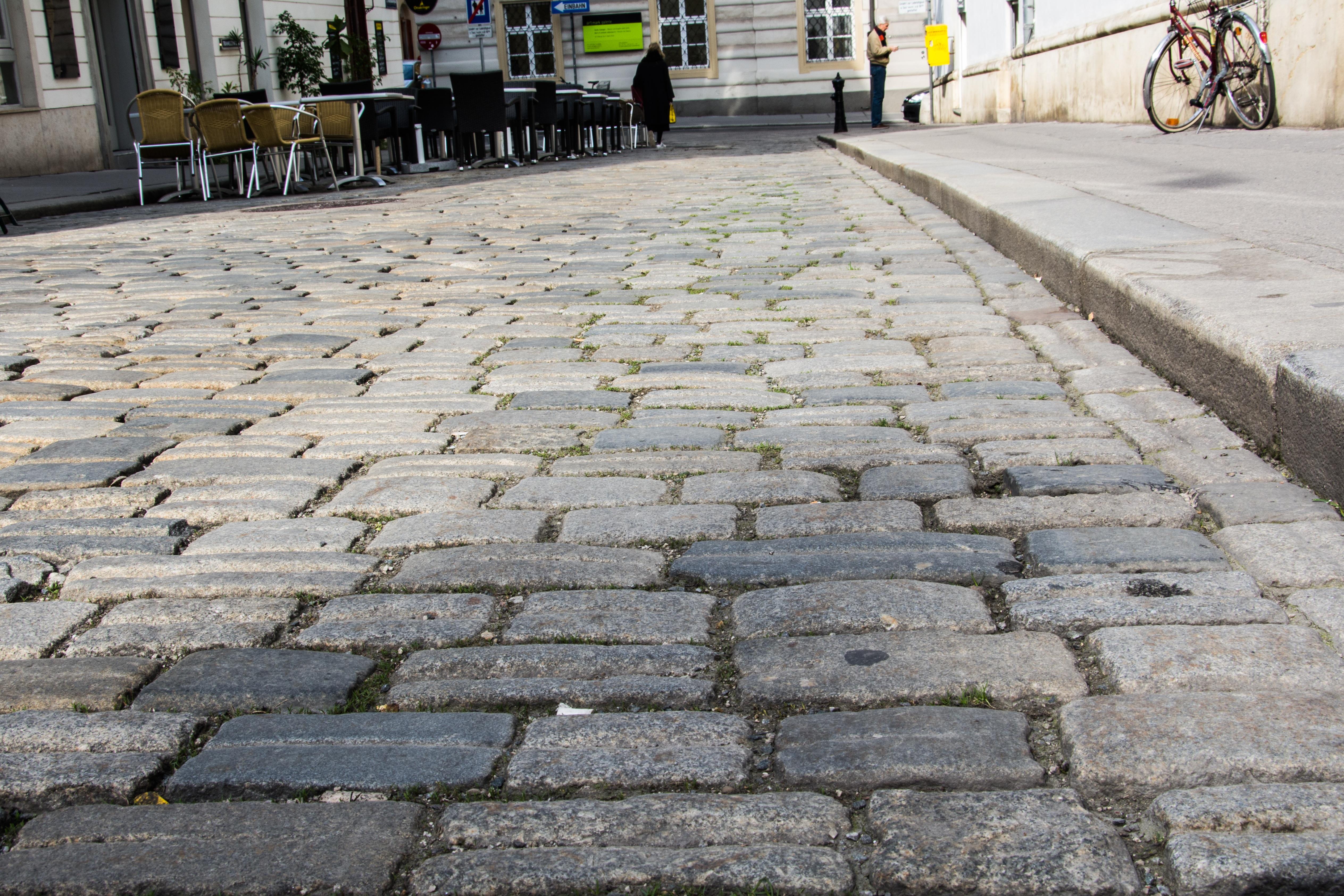 city asphalt walkway stone wall brick lane public space old town vienna driveway paving stones pedestrian zone