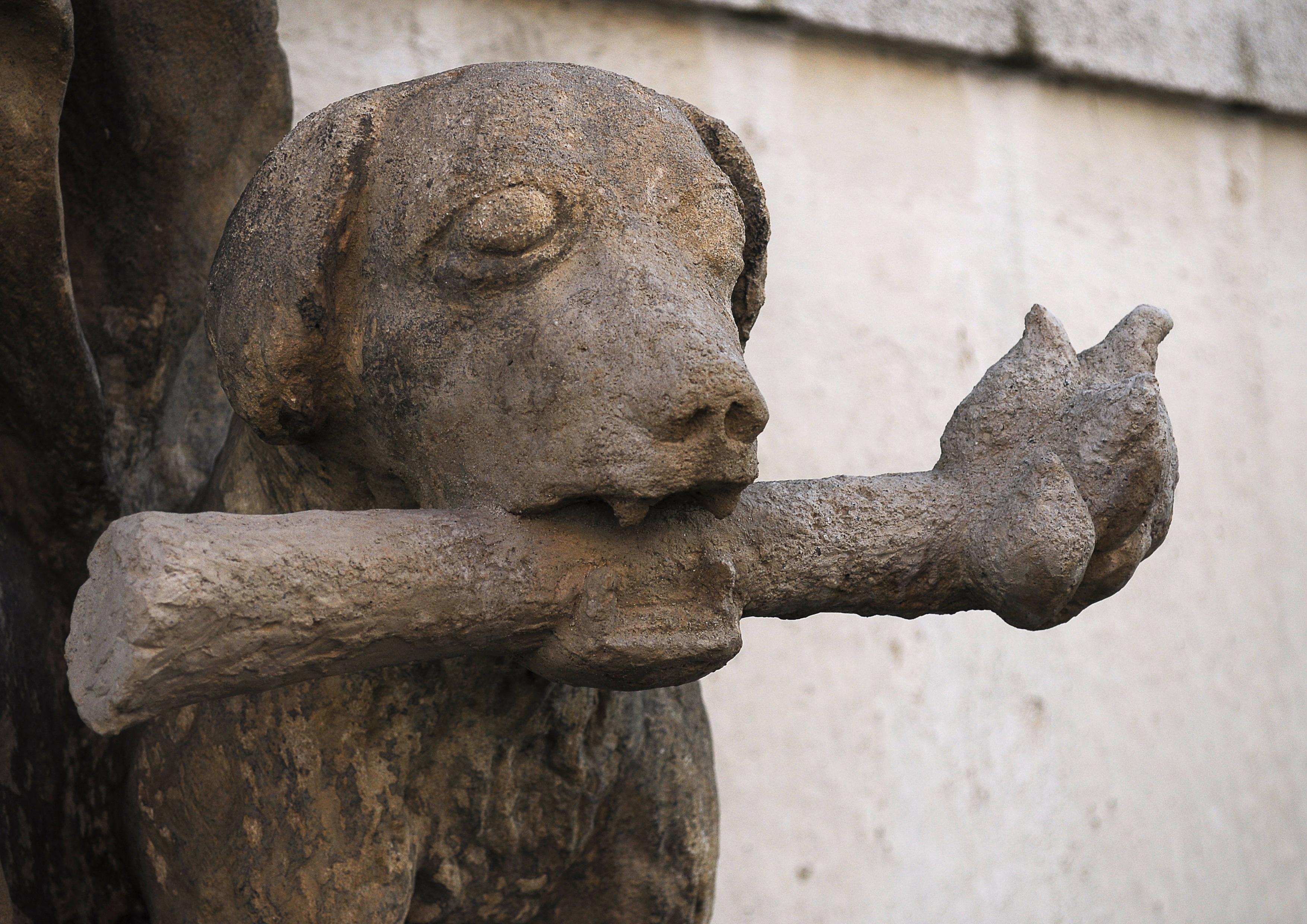 Free Images : rock, wood, dog, monument, statue, torch, gargoyle ...