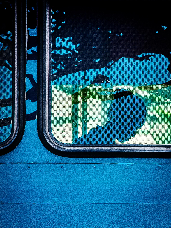 8dde74ec5d47ba silhouette woman window glass wall tram green reflection color blue art  illustration shape commuter