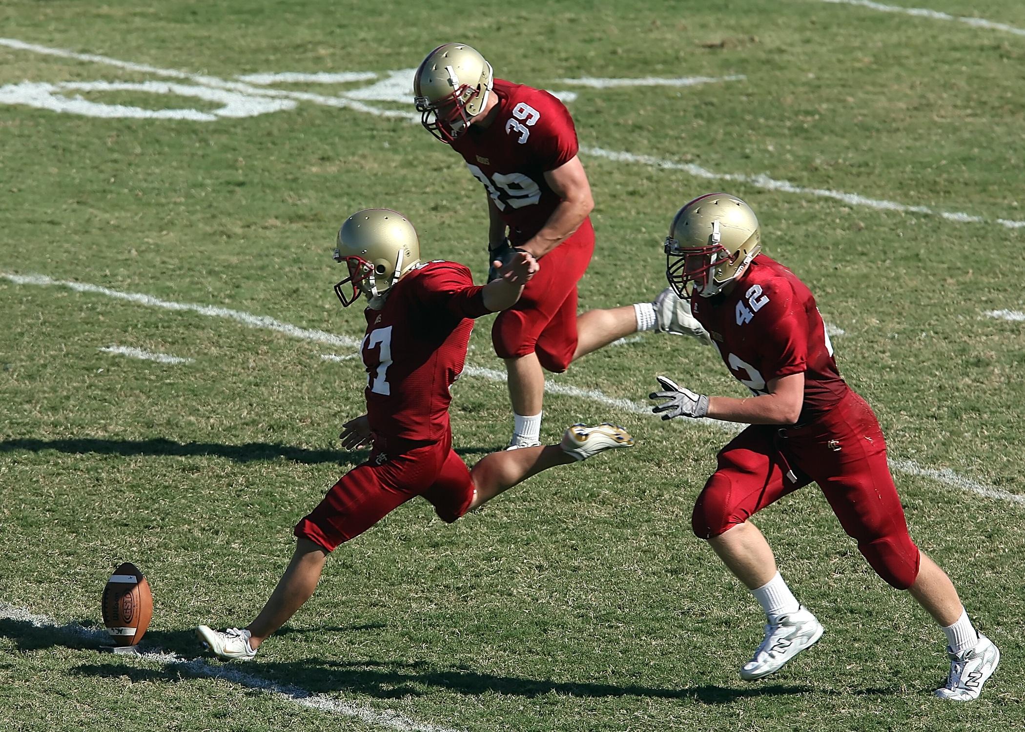 Trio play in field