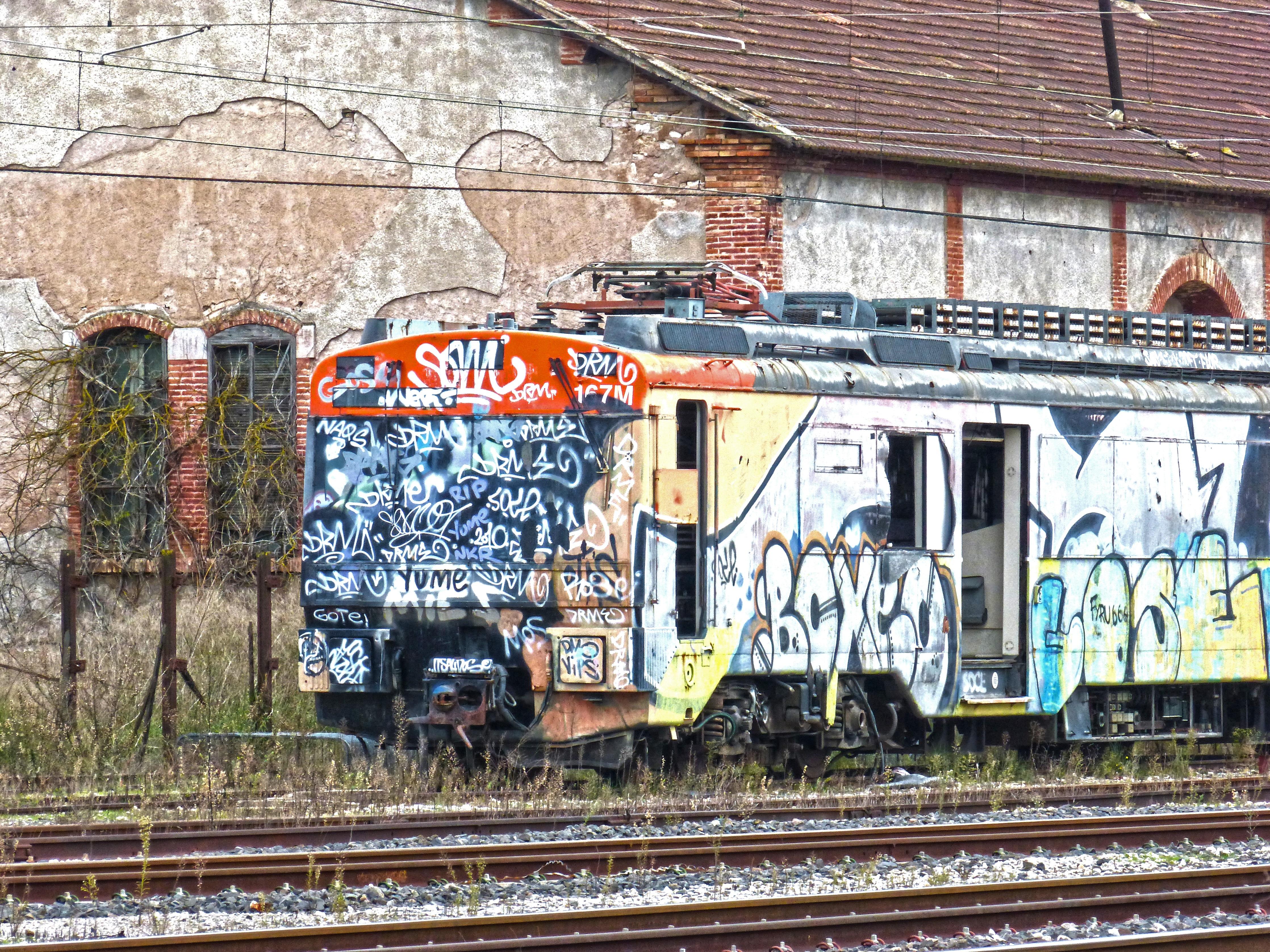 Track train transport vehicle abandoned graffiti art locomotive vandalism rail transport urban area rolling stock railroad