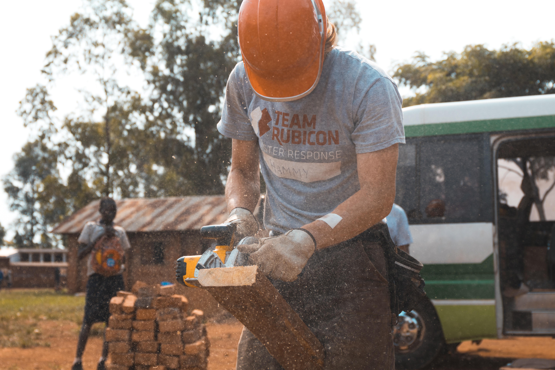tree grass plant wood soil laborer lumberjack wood chopping construction worker bricklayer - Construction Laborer