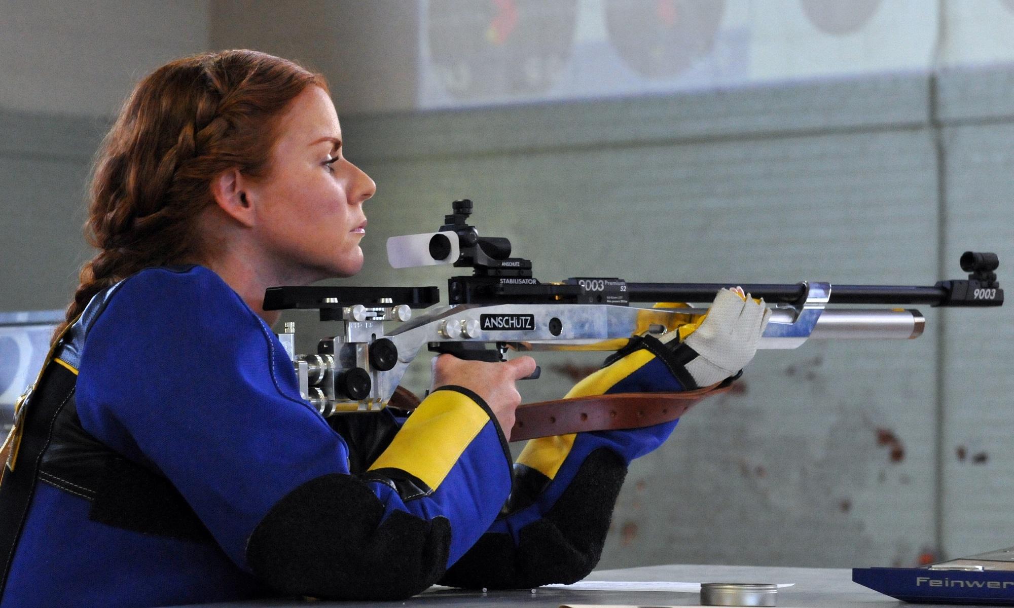 c0f412d04b56a woman sport range recreation female weapon competition shooting sports gun  shoot rifle games target aim shooter